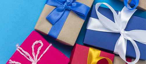 A lot of gift boxes on a blue background. Holiday concept, New Year, Christmas, Birthday, Valentine's Day. Copy space. Flat lay, top view