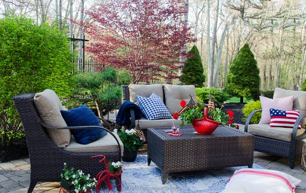 Patriotic backyard patio with red, white and blue decorations.
