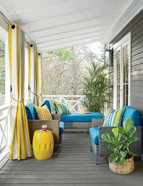 Blue and yellow tropical front porch decor.