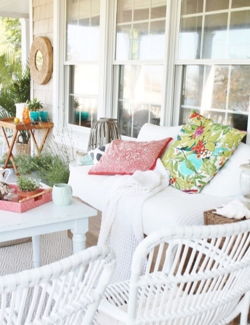 Coral and blue front porch decor.
