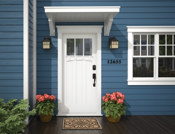 White front door with Schlage Connect Smart Deadbolt.