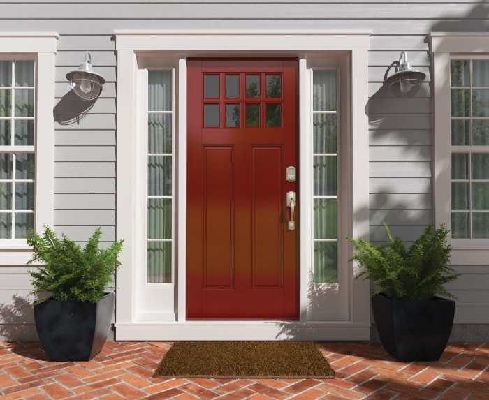 Red front door with Satin Nickel handlest and smart lock.