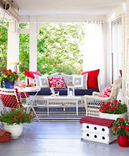 Red and white front porch decor.