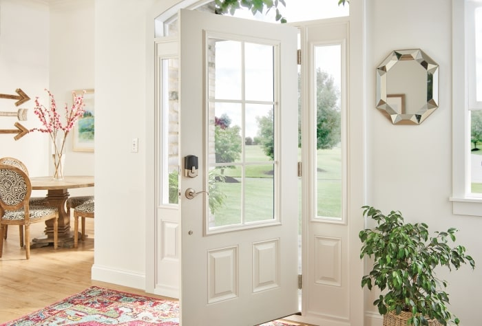 Schlage smart lock on front door with windows.