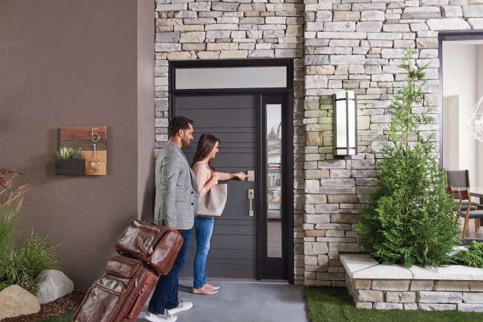 Guests arriving at vacation rental with Schlage smart locks.