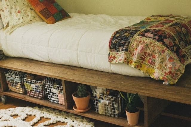 Wire baskets for under bed storage.