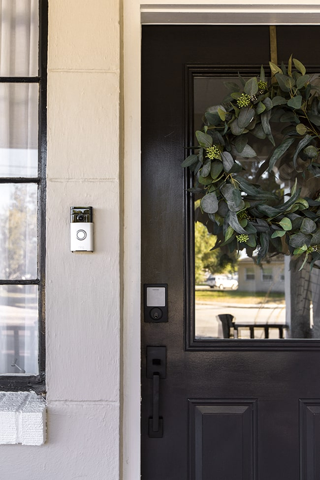 Schlage Sense Smart Deadbolt on black front door.