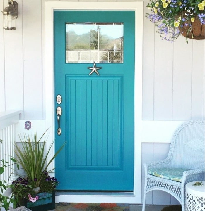 Coastal style blue front door with starfish door knocker.