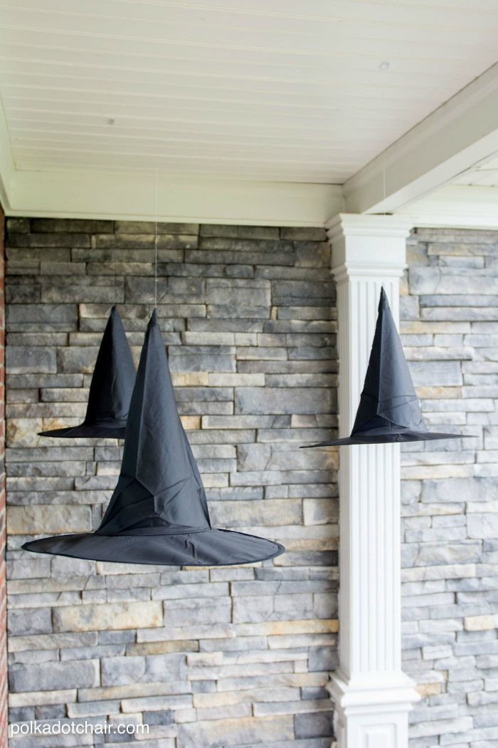 DIY floating witch hats on front porch.