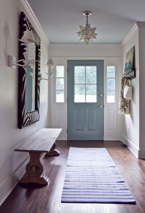 Organized entryway with coastal blue door.