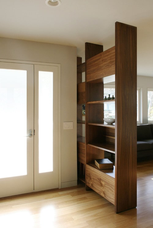 Entryway with bookcase divider.
