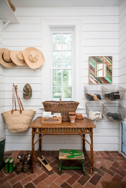 Mudroom with table and wire baskets