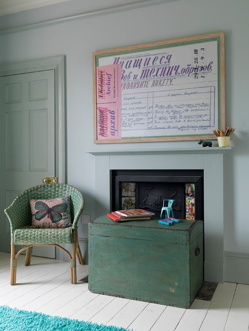 Farmhouse room painted with green hues.