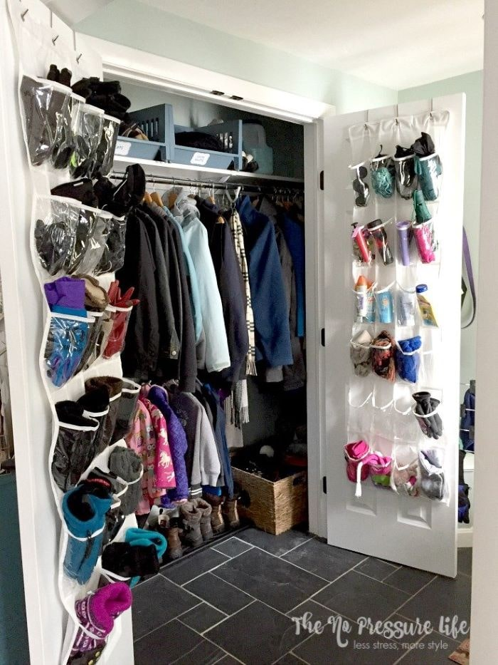 Over-the-door shoe organizer for mudroom storage.