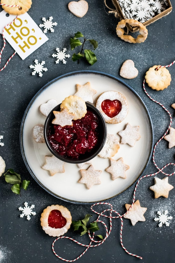 Holiday thumbprint cookies on a plate.