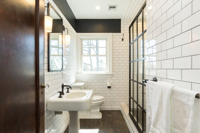 Transitional bathroom with subway tile and dark grout.