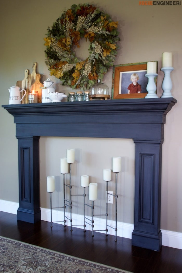 Faux fireplace mantel with decor.