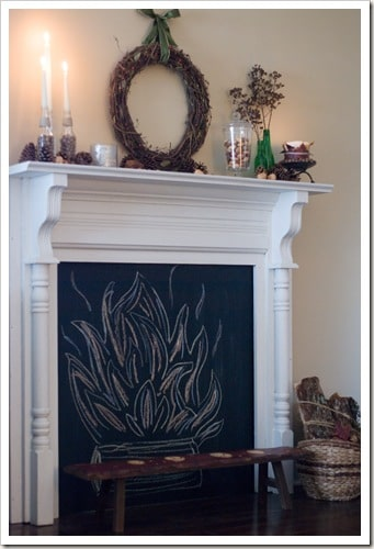 Faux fireplace with chalkboard insert.
