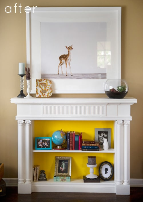 Faux mantelpiece with bookcase inside.