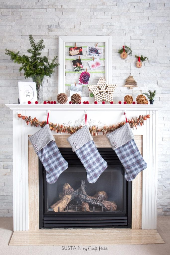 Fireplace mantel with holiday decor.