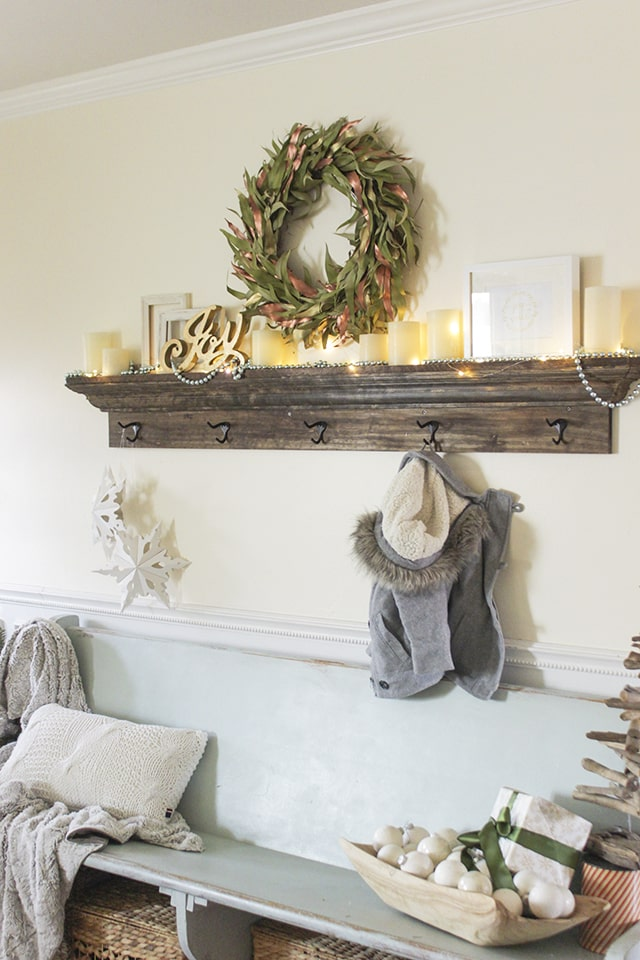 Entryway shelf with holiday mantel vignette