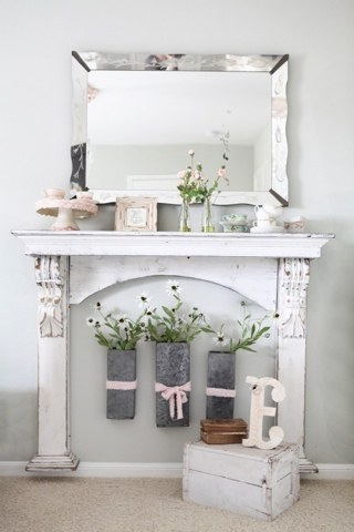Farmhouse faux mantel with flower vase insert.