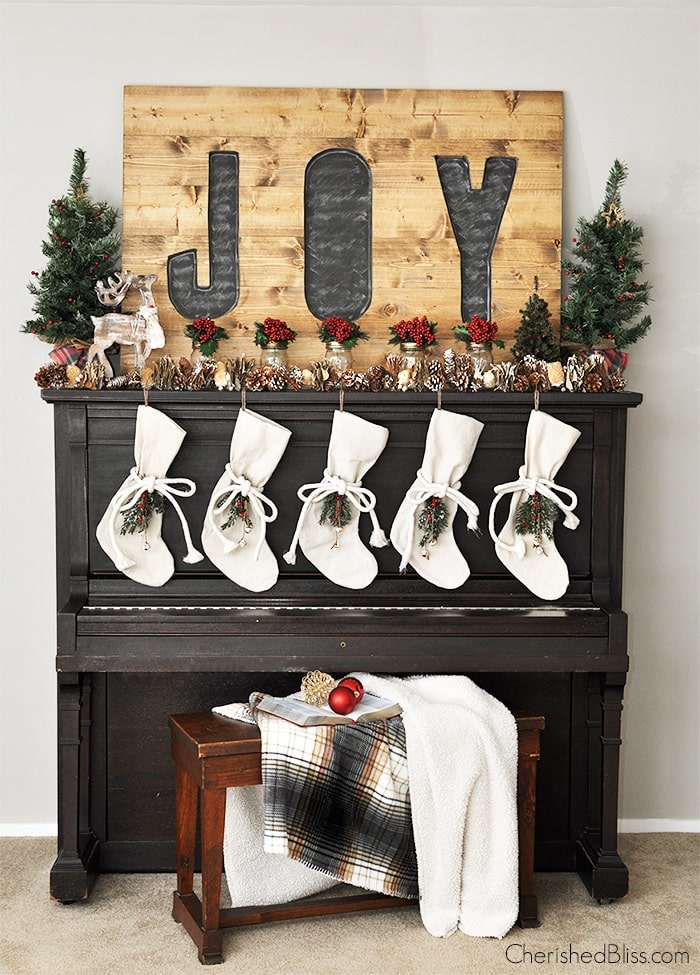 Black piano with holiday mantel vignette.