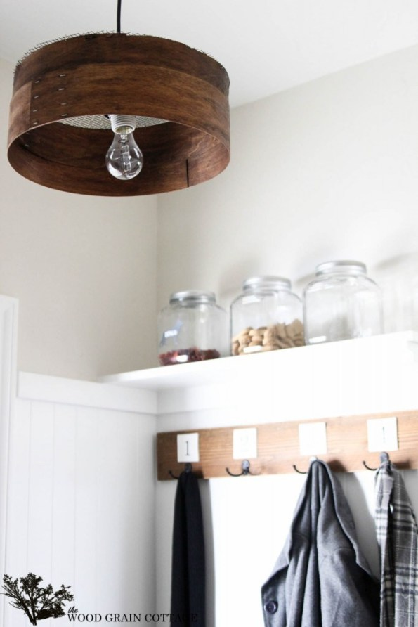 DIY Farmhouse Grain Sieve Light fixture hanging in entryway.