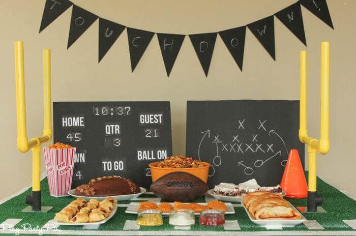 Football party food spread with DIY goal posts.