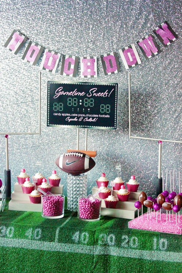 Pink football party dessert spread.