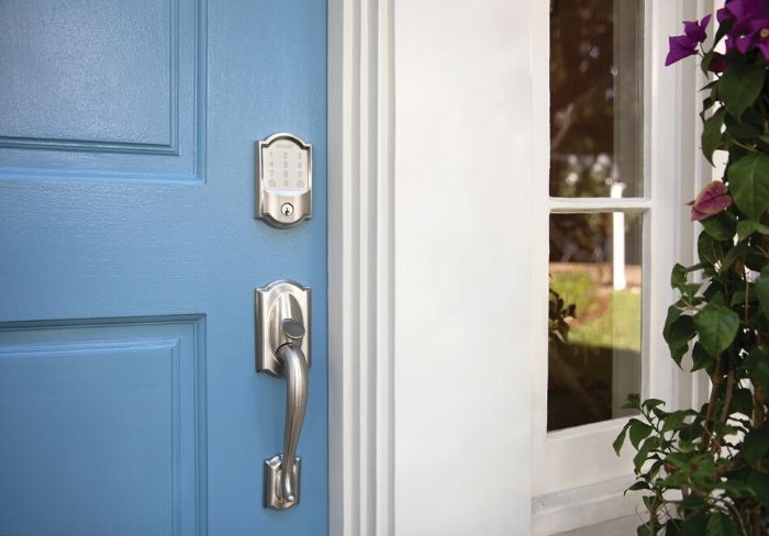 Schlage Encode wifi smart lock on blue front door.