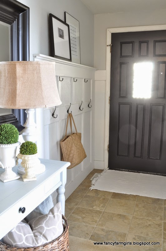 Small farmhouse entryway with wall hooks.