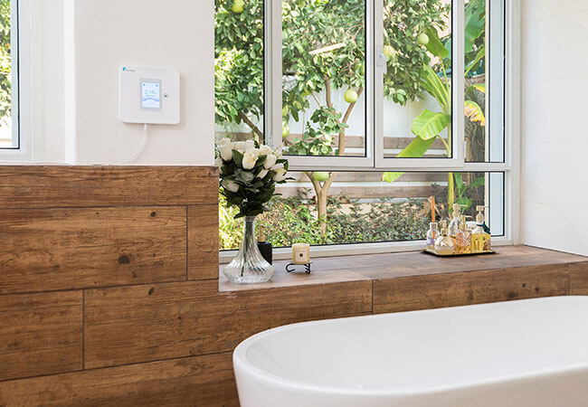 Walabot HOME fall detecting robot panel set up in bathroom