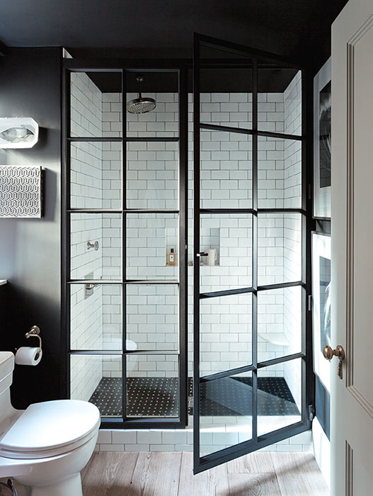 Bathroom with glass doors and mixed finishes.