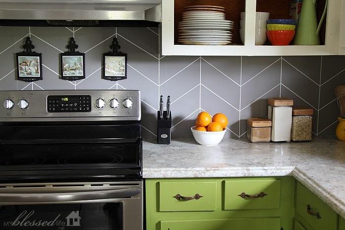 DIY painted herringbone kitchen backsplash.