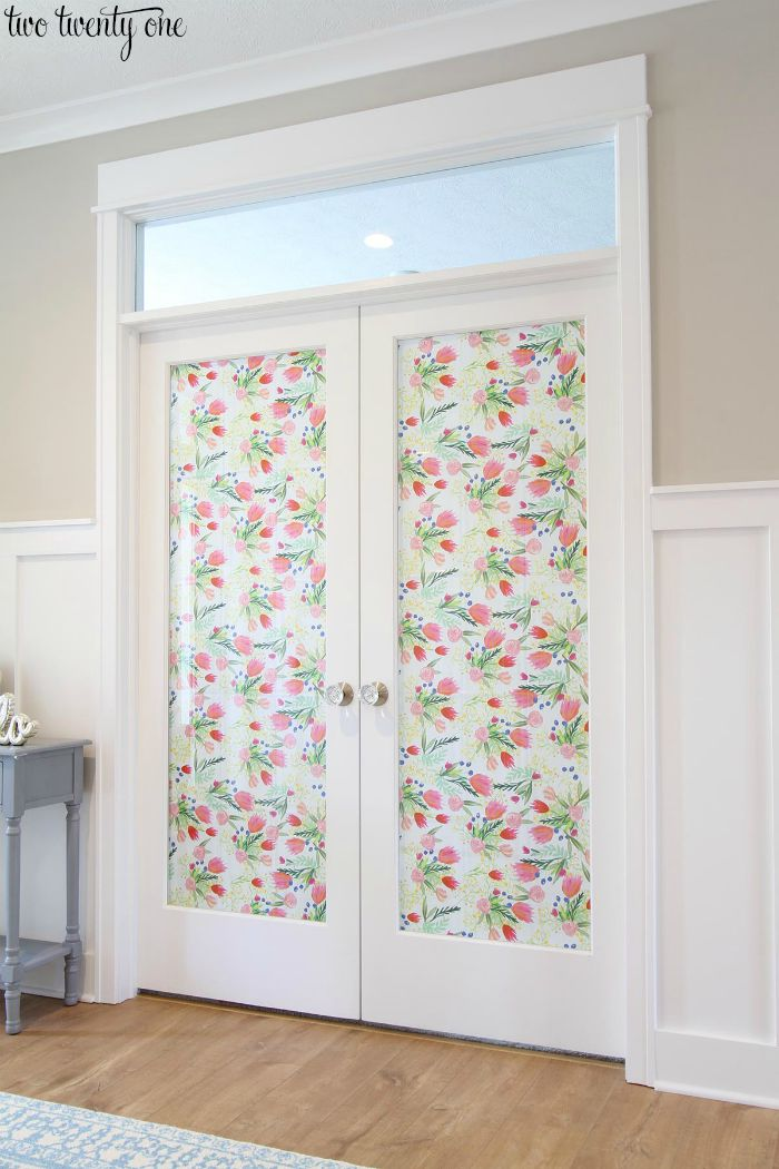 French doors with decorative paper and Schlage glass knobs.