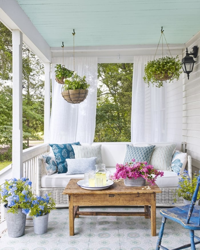 Country front porch with hanging plants.