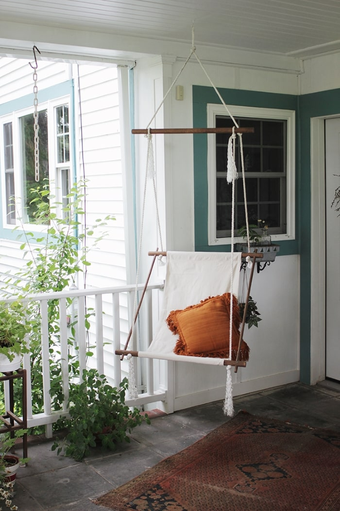 DIY hanging rope chair on front porch.