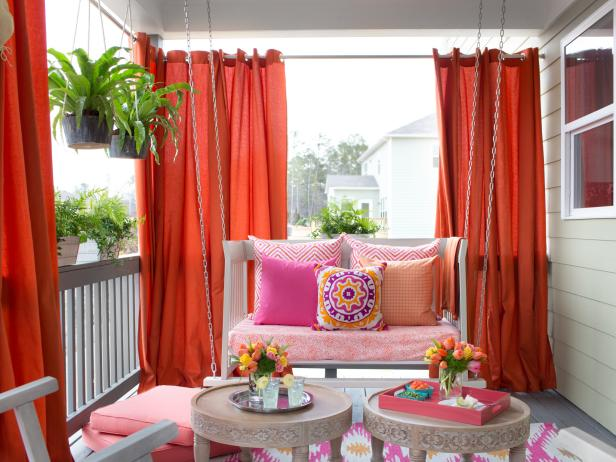 Front porch with outdoor drapes.