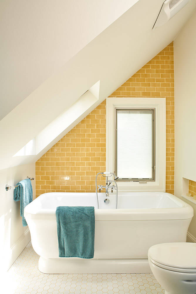 Bathroom with yellow tile.