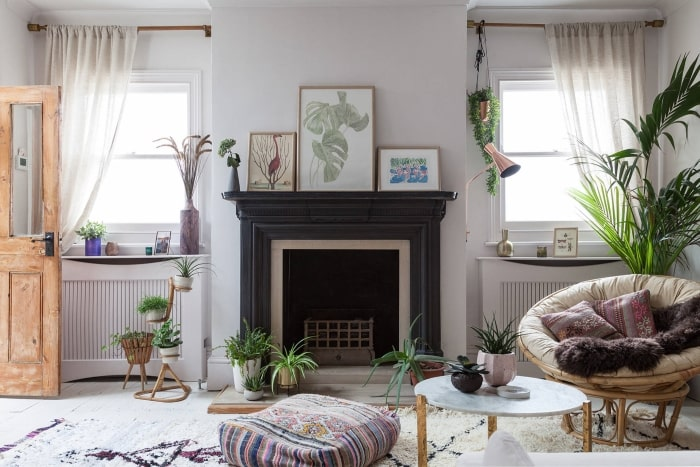 Eclectic Victorian living room with fireplace.