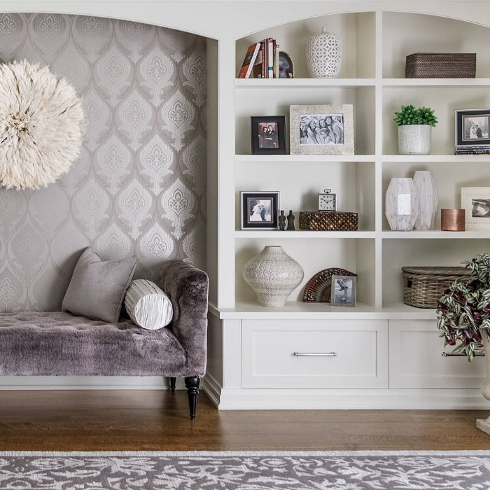 Purple sitting nook with built-in bookcase.