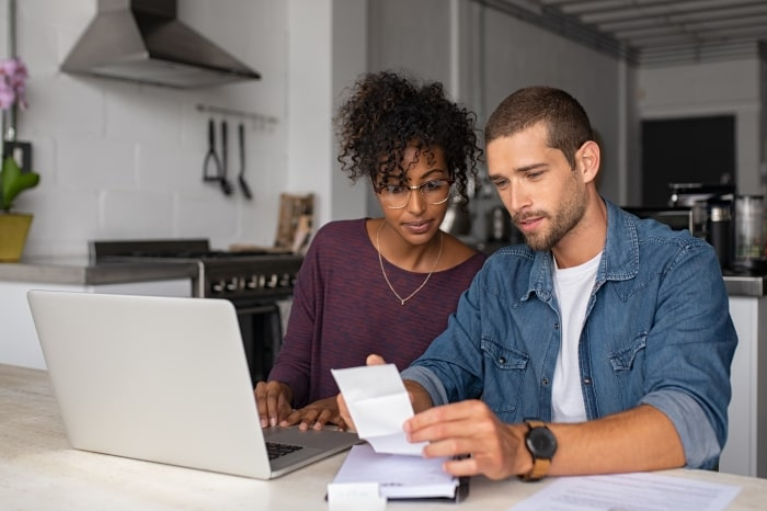 Couple working on home finances.