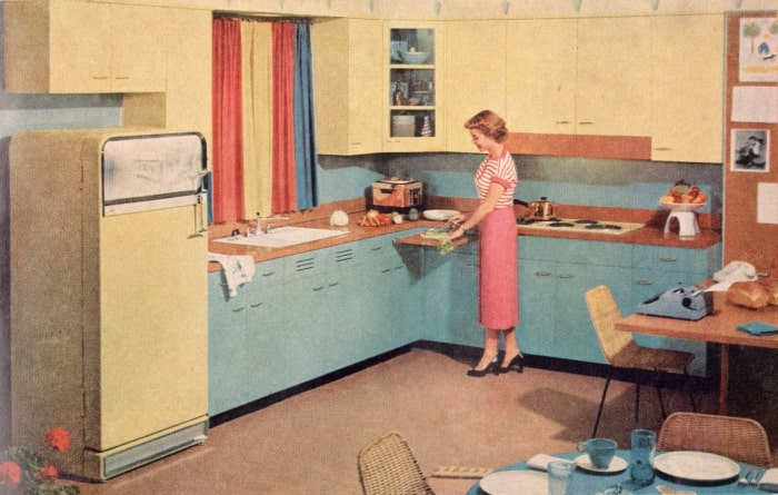 1950s kitchen with blue cabinets and yellow appliances.