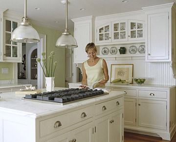 White kitchen with island cooktop.