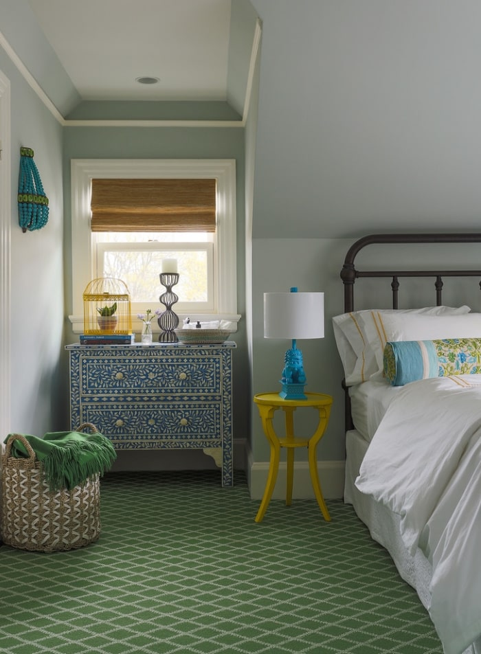 Green and blue guest bedroom with global inspired accents.