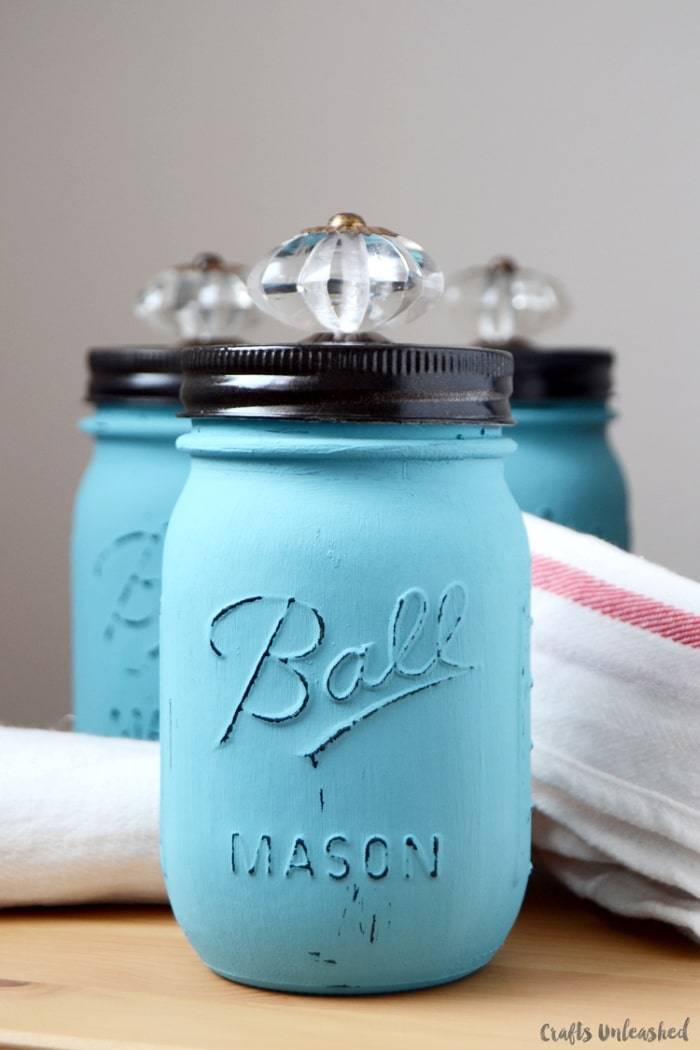 DIY storage jars with crystal knobs.
