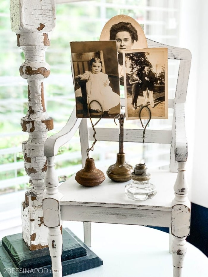 DIY photo holder using old door knobs.