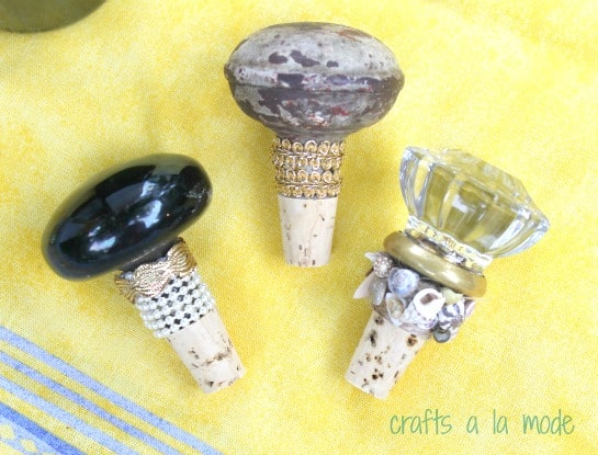 DIY wine bottle stoppers with door knobs.