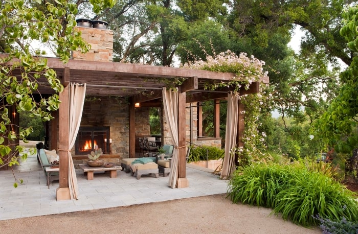 Neutral patio with pergola and drapes.